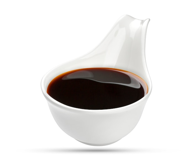 Soy sauce in bowl isolated on white Premium Photo