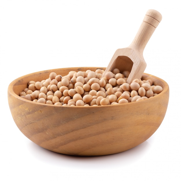 Soybean in a wooden bowl isolated on white background Premium Photo
