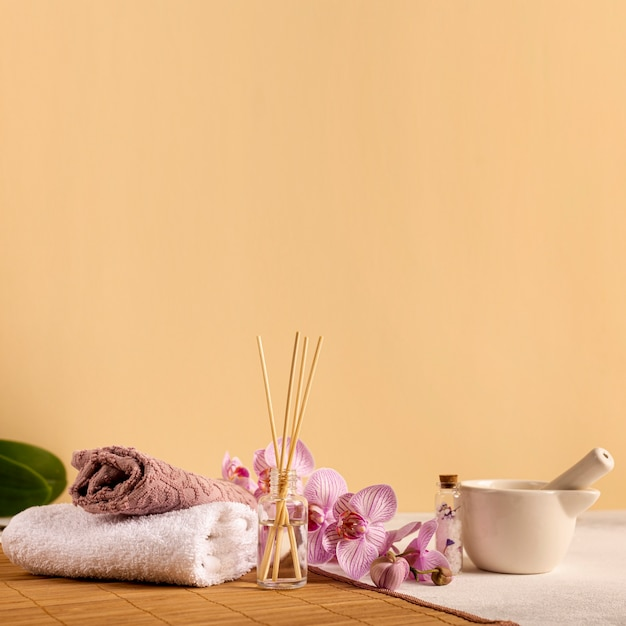 Spa arrangement with towels and flowers Free Photo