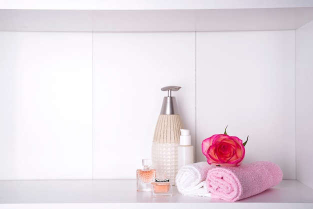 Spa bath cosmetic and flower rose, isolated on white. dayspa nature products Premium Photo