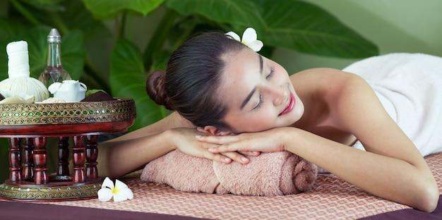 Spa body massage woman hands treatment. woman having massage in the spa salon Premium Photo