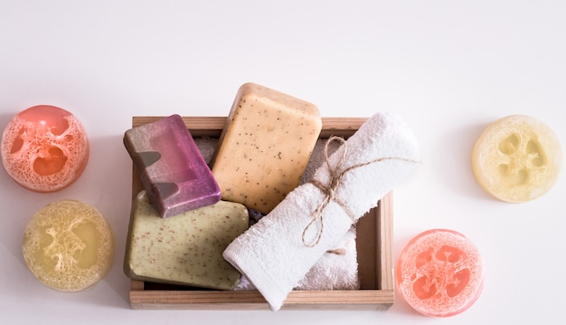 Spa composition on white background soap in box Free Photo