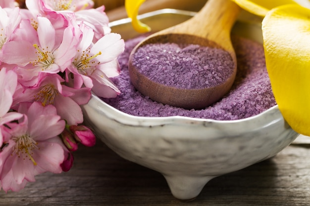 Spa Concept. Closeup of beautiful Spa Products - Spa Salt and Flowers. Horizontal. Free Photo