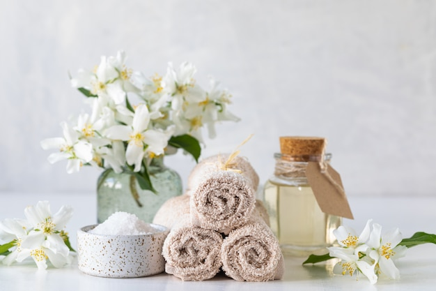 Spa concept of jasmine oil, with bath salt and flowers Free Photo
