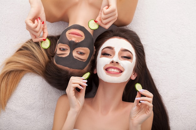 Spa. group woman getting facial mask and gossip Premium Photo