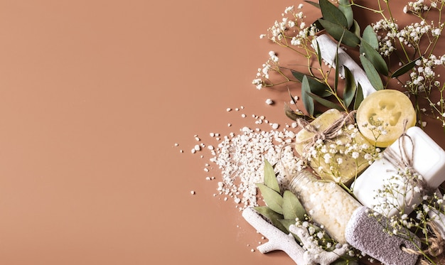 Spa or health plan frame with towels, soap, leaves, flowers, bath bombs Premium Photo