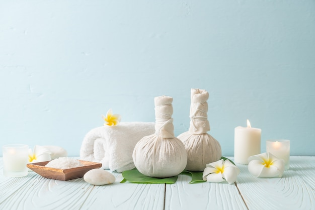 Spa herbal compressing ball with candle and orchid Premium Photo