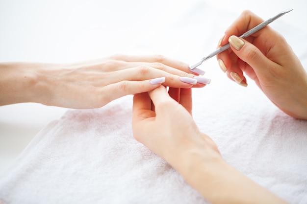 Spa manicure, french manicure at spa salon Premium Photo
