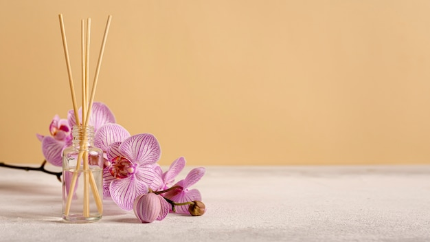 Spa therapy with flowers and scented sticks Free Photo