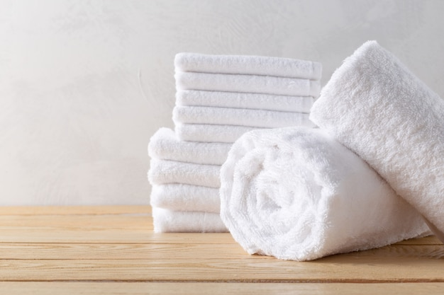 Spa towels on wooden surface Premium Photo