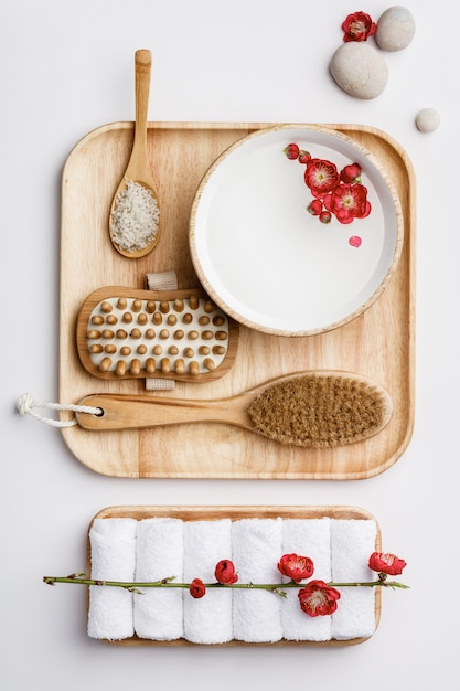 Spa treatment concept, flat lay composition with natural cosmetic products and massage brushes Premium Photo