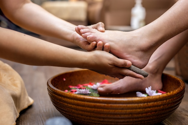 Spa treatment female feet is a healing for relaxation Premium Photo