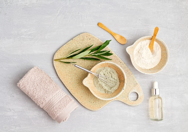Spa and wellness composition with serum, towels and beauty products Premium Photo