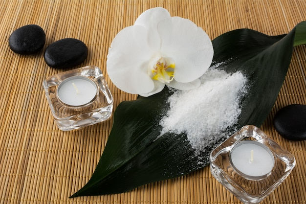 Spa and wellness concept with sea salt and orchid Premium Photo
