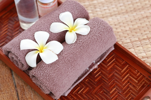 Spa and wellness setting with frangipani flowers. concept for spa and thai massage Premium Photo