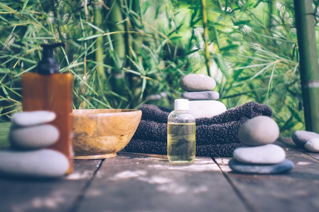 Spa with bamboo leaves and stones Premium Photo