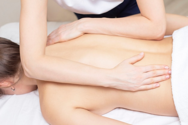 Spa woman body massage with hands treatment. Premium Photo