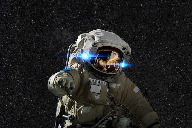 Spaceman in space on the background of stars Premium Photo
