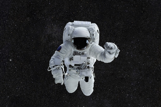 Spaceman travels in space Premium Photo