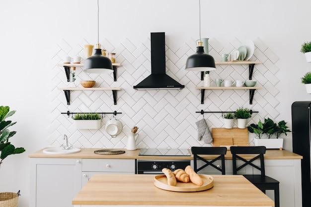 Spacious modern scandinavian loft kitchen with white tiles. bright room. modern interior. Premium Photo