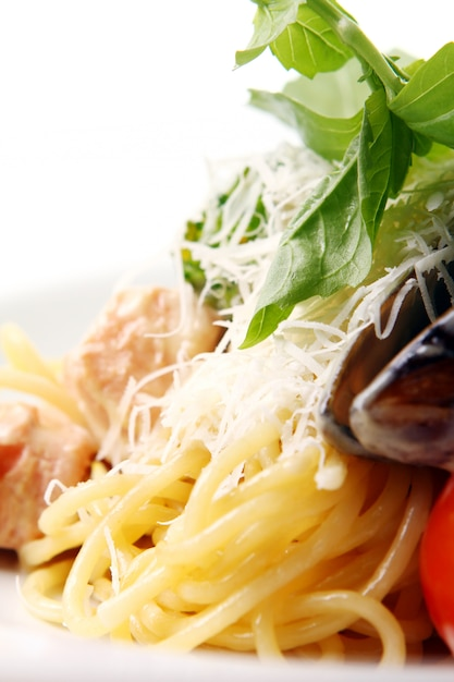 Spaghetti and meat with cheese basil and mussels Free Photo