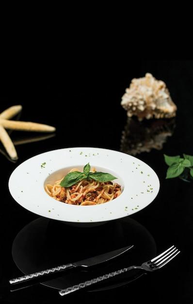 Spaghetti in tomato red pepper sauce. Free Photo