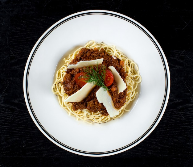 Spaghetti with meat gravy and parmesan Free Photo
