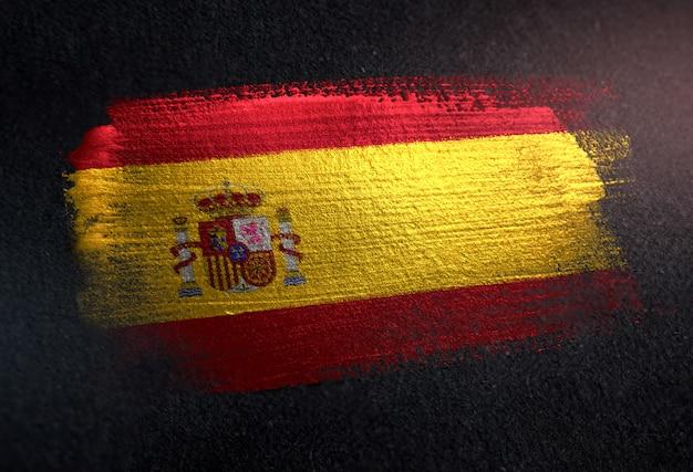 Spain flag made of metallic brush paint on grunge dark wall Premium Photo