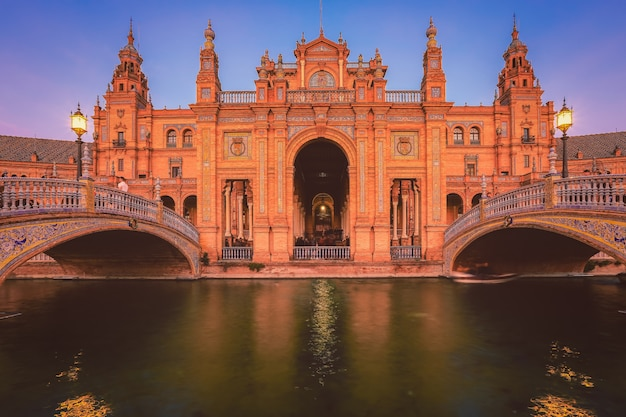 Spain square or plaza de espana in seville during evening blue hour, andalusia, spain Premium Photo