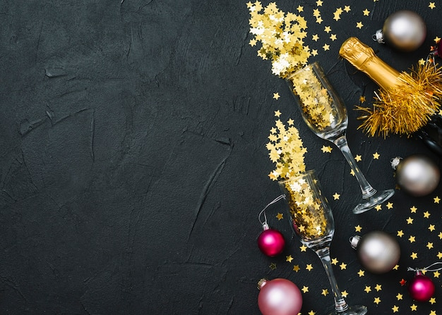 Spangles in glasses with baubles Free Photo