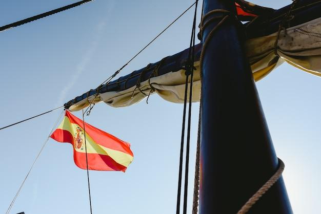 Spanish flag on commercial sailing ship Premium Photo