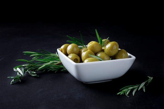 Spanish olives with leaves Premium Photo