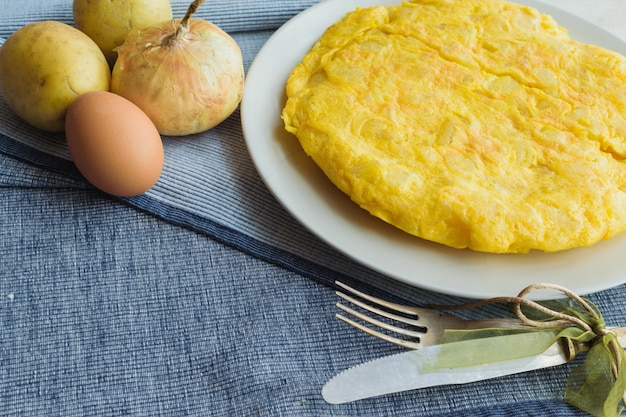 Spanish omelette called tortilla de patatas with vintage cutlery Premium Photo
