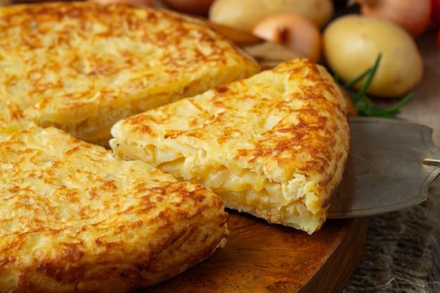 Spanish tortilla with potatoes and onion. Premium Photo