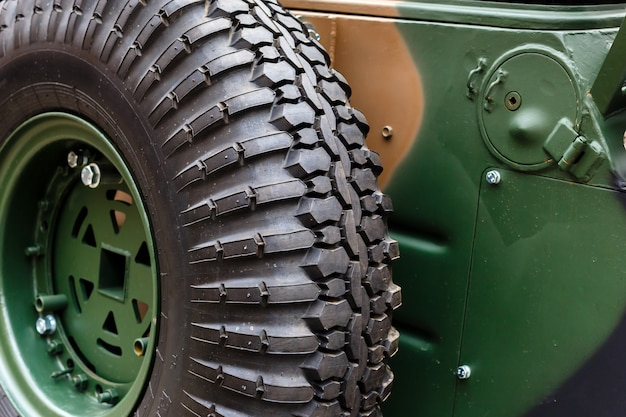 Spare wheel close-up mounted on the body of an armored car Premium Photo