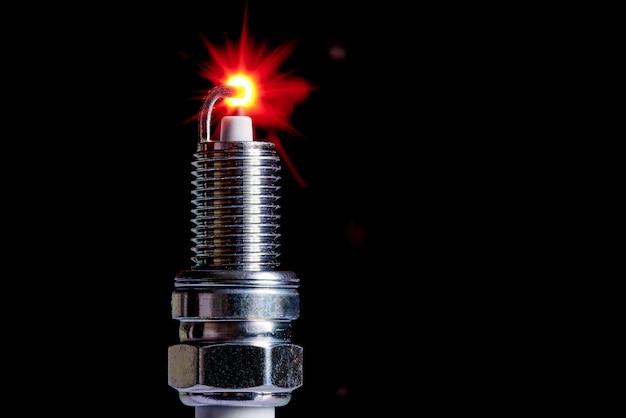 Spark plug for internal combustion engine. copy space. Premium Photo