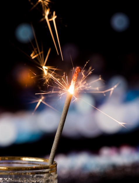 Sparkler in transparent glass with bokeh light background Free Photo