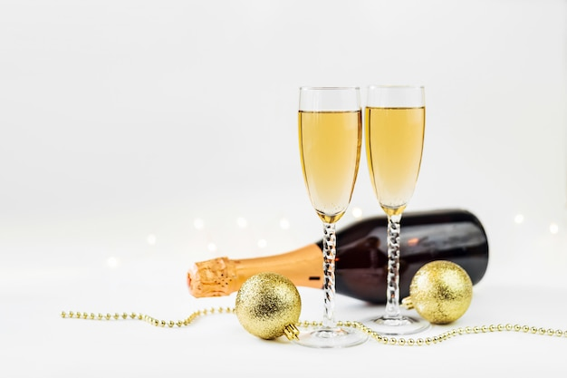 Sparkling new year  background with champagne, bottle and decorations .christmas and happy new year concept. Premium Photo