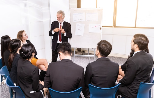Speaker at business meeting roon or conference room and audience. Premium Photo
