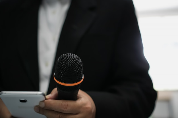 Speaker or businessman hold microphone for speech or speaking in seminar conference room Premium Photo