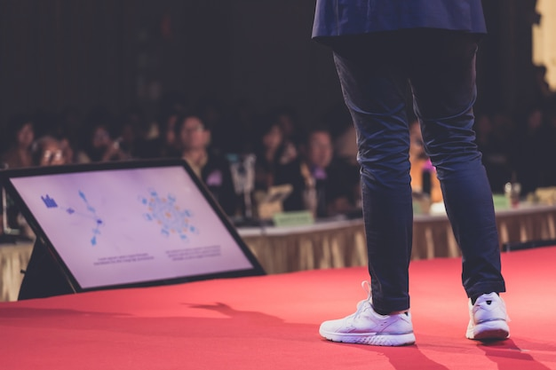 Speaker on stage in a conference room Premium Photo