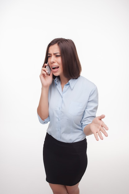 Speaking business woman on white wall Free Photo