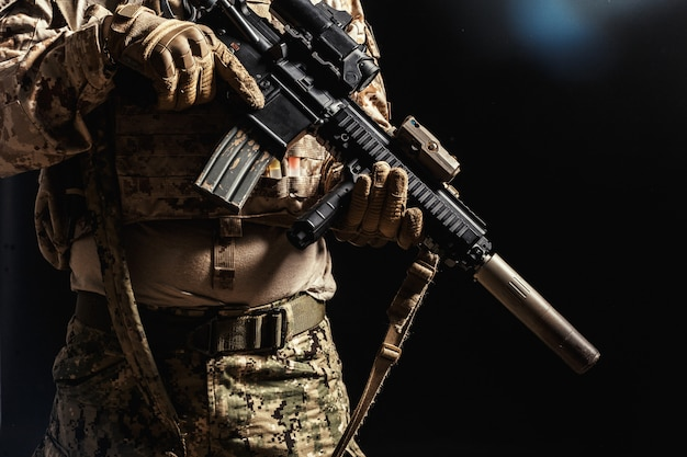 Special forces soldier with rifle on dark Premium Photo