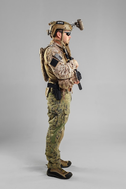 Special forces soldier with rifle on white. Premium Photo