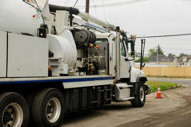 A specialized sewer cleaning machine works on a street. Premium Photo