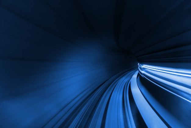 Speed blurred motion of train or subway train moving inside tunnel. Premium Photo