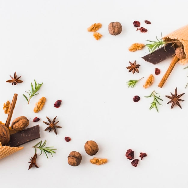 Spices and nuts near waffle cones Free Photo