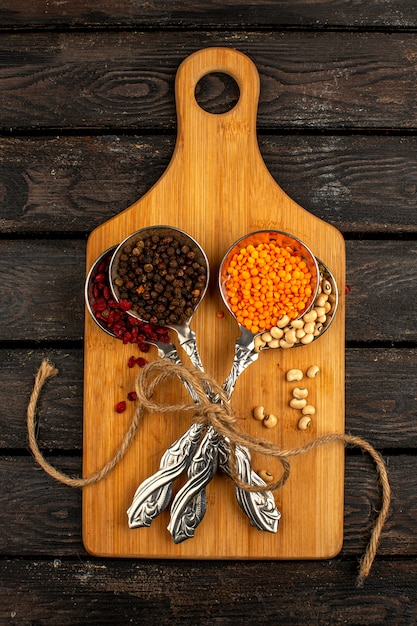Colorful Spoons: Spices Beans Colorful Raw Inside Silver Spoons On A Wooden