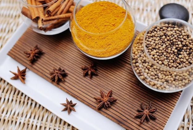 Spices in a beautiful dish in spa salon close up Premium Photo
