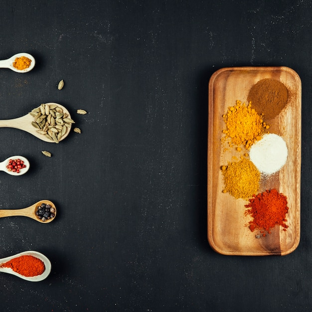 Spices composition with five spoons and board 23 2147684889
